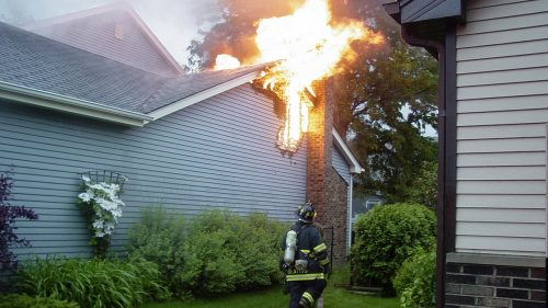 Firefighter Fighting a House Fire